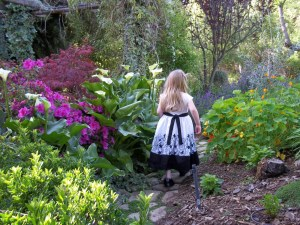 Girl walking in garden
